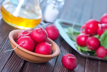 fresh radish in bowl and on a table photo
