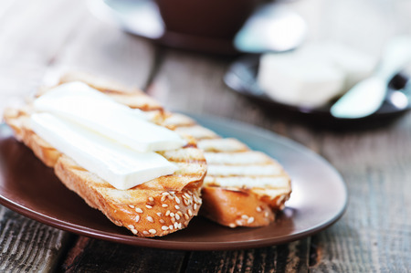 bread with butter and fresh coffee in cup photo