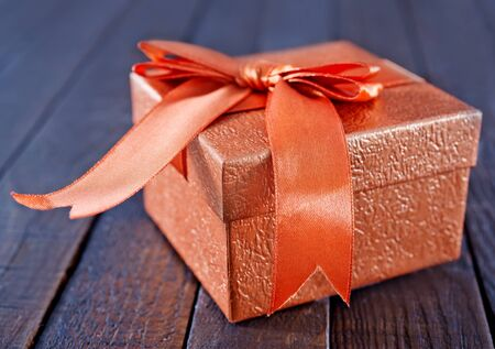 box for present on the wooden table photo