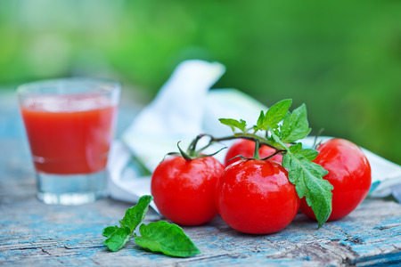 tomato juice in glass and on a table photo