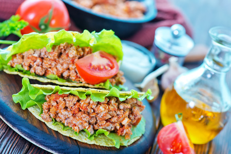 rustic food: taco with meat and tomato on a table Stock Photo