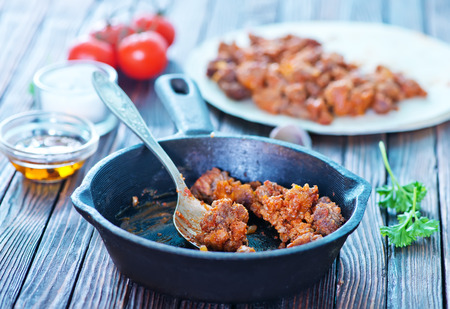 farce: minced meat with tomato sauce in pan