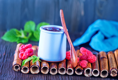 light breakfast: raspberry jam in bank and on a table