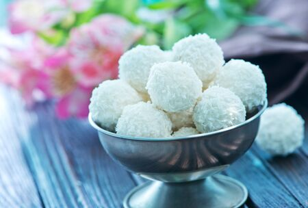 panellets: coconut balls in metal bowl and on a table