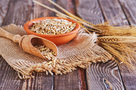 kasha: dry  oat in bowl and on a table