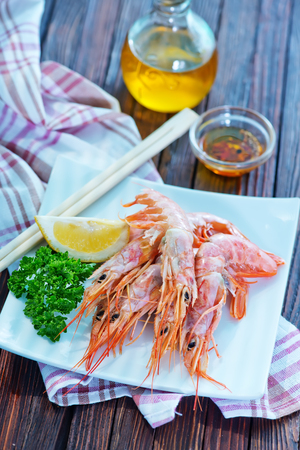 caterers: fried shrimps on white plate and on a table