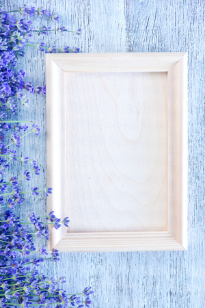 green frame: lavender on a table, flowers on the wooden background