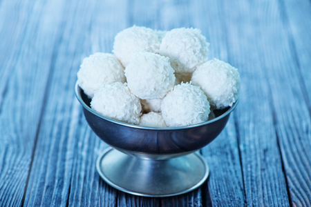 panellets: sweet coconut balls on the wooden table