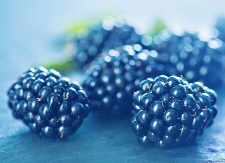 frash: frash blackberry on the black table, summer berries Stock Photo
