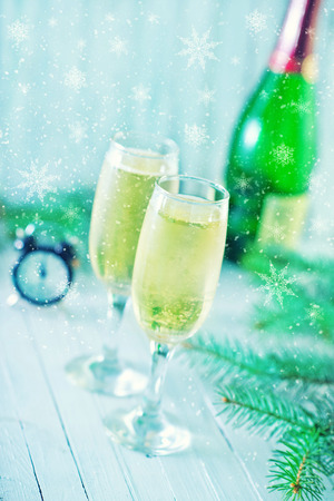s eve: two shampagne glasses and decoration for christmas tree