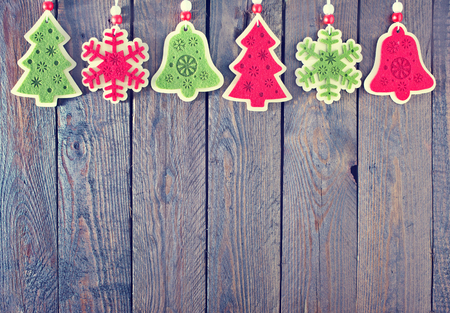 hanging banner: christmas decoration for tree on wooden table Stock Photo