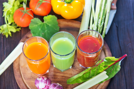 vegetable juice in the glass and on a table