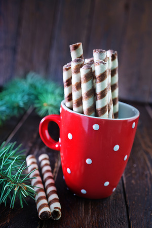 for tea: Christmas treat, sweet biscuit tubes for tea Stock Photo