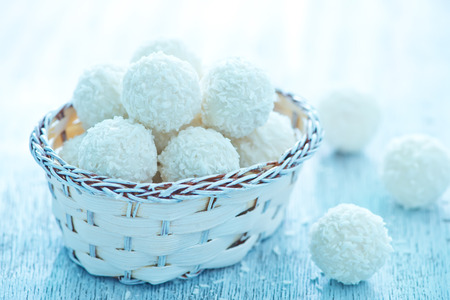 panellets: coconut balls in basket and on a table