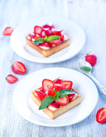 sweet food: fresh cake with fresh strawberry on a table Stock Photo
