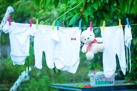 baby clothes in garden, clear baby clothes Standard-Bild