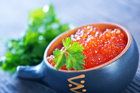 red salmon: red salmon caviar with fresh parsley on a table Stock Photo