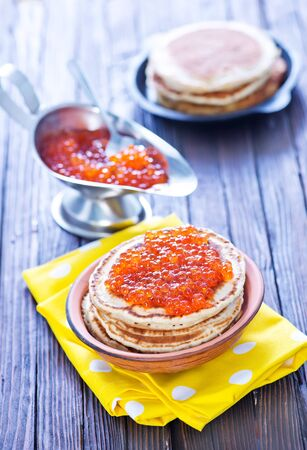 red salmon: pancakes with red salmon caviar on plate Stock Photo