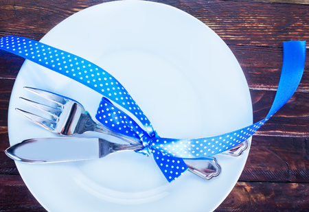 Centrepiece: holiday place (table) setting, fork and knife on plate