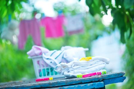 natural childbirth: baby clothes, clear baby linnen in garden