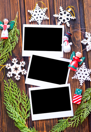 blank photo: Vintage photo frames decorated for Christmas on the wooden board