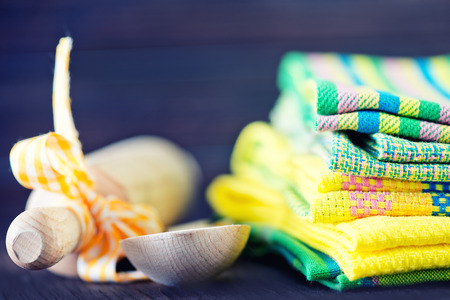 textil: stack of kitchen towels on the wooden table