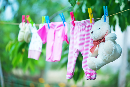 clothes shopping: baby clothes, clear baby linnen in garden