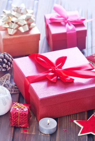 xmas background: boxes for present on the wooden table, xmas background