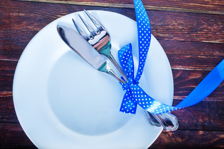 Centrepiece: fork and knife on plate