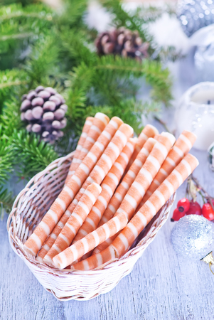 desert: waffle rolls and christmas decoration on the table