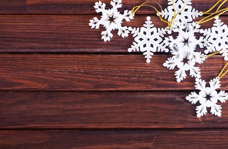 winter decorations: christmas decoration on the wooden table, christmas background