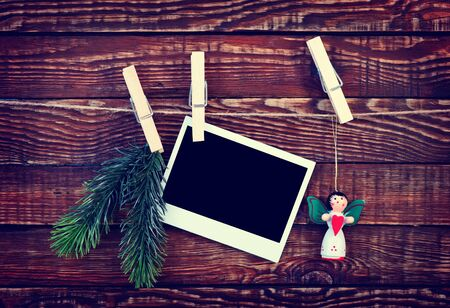 cadre: Christmas background.photo on wood background decorated with christmas clothespin Stock Photo