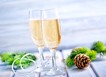 hearthside: Two Champagne Glasses on the wooden table Stock Photo
