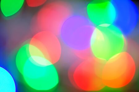 defocussed: christmas background, Background of defocussed color lights with sparkles Stock Photo