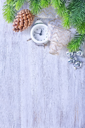 12 month old: Christmas background, Christmas decoration and clock on a table