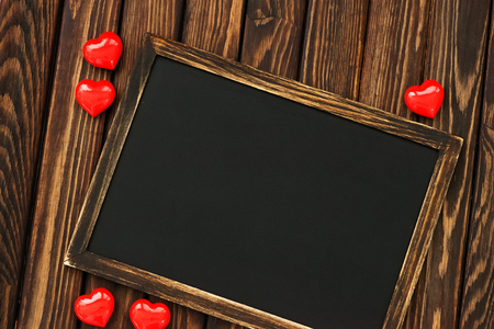 i love u: hearts and blackboard on the wooden background Stock Photo