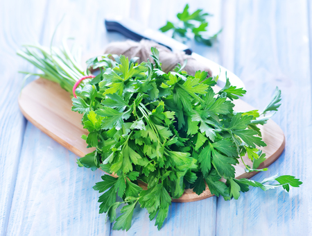 prep: parsley on wooden board and on a table