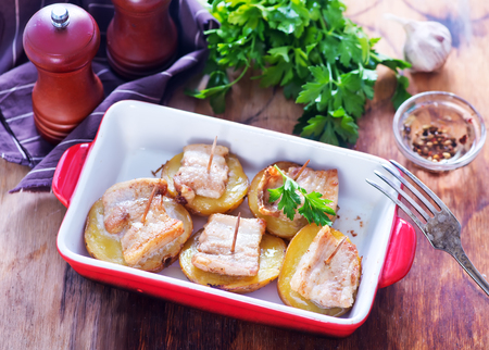 baked potato with lard on plate and on a table Stock Photo