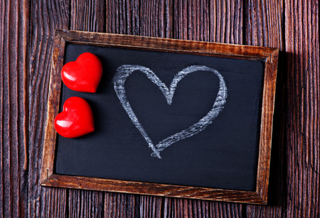 blank photo: red hearts and black board on a table