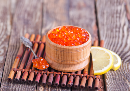 red salmon caviar in bowl and on a table Фото со стока - 53729370