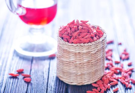 barbarum: dry red berries, dry goji berries on a table
