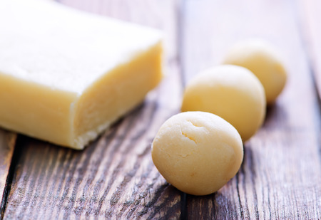 balls from marzipan, marzipan on a table