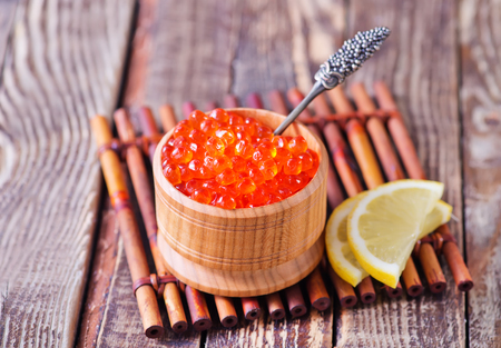 red salmon: red salmon caviar in bowl and on a table