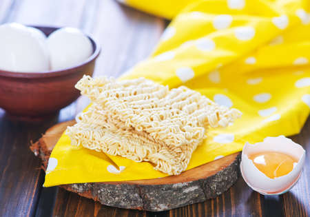 boodle: raw egg noodles on the wooden board