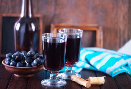 des vins: grape wine in glass and on a table