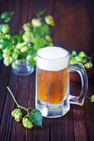 unbottled: fresh beer in glass on the wooden table