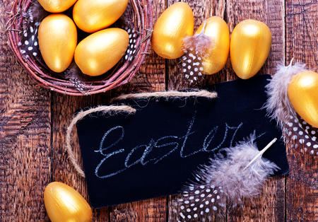 retiring: golden eggs in nest and on a table