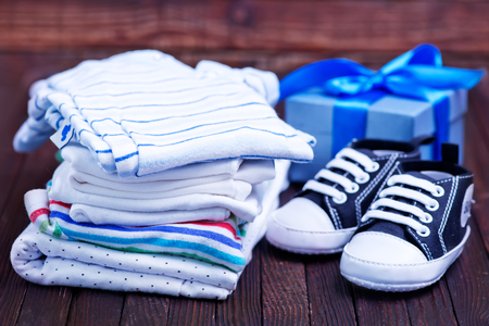 Clear baby clothes on the wooden table Stock Photo