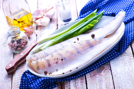 white backing: raw fish on plate and on a table Stock Photo