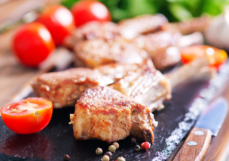 mutton chops: fried meat with spice on a table